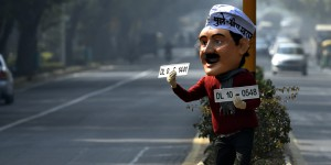 NEW DELHI, INDIA - DECEMBER 30: A dummy of Delhi CM Arvind Kejriwal is seen on the road promoting odd-even campaign on December 30, 2015 at Ferozshah Road in New Delhi, India. The odd-even number plate policy will come to force in Delhi from January 1 till January 15. Delhiites stand divided over the implementation of the odd-even plan, with some supporting the novelty of congestion-free roads while others mocking the impracticality of it. (Photo by Ravi Choudhary/Hindustan Times via Getty Images)